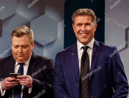 Former Prime Minister Sigmundur David Gunnlaugsson (L) leader of the Centerparty, and current Prime Minister Bjarni Benediktsson (R) leader of the Independence party attend a television debate