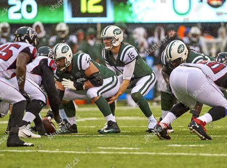 East Rutherford, New Jersey, U.S. - Jets' quarterback Josh McCown (15) calling signals underneath center Wesley Johnson (76) during NFL action between the Atlanta Falcons and the New York Jets at MetLife Stadium in East Rutherford, New Jersey
