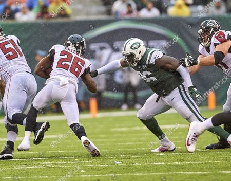 East Rutherford, New Jersey, U.S. - Falcons running back Tevin Coleman (26) is tackled by Jets' defensive linemen Muhammad Wilkerson (96) during NFL action between the Atlanta Falcons and the New York Jets at MetLife Stadium in East Rutherford, New Jersey