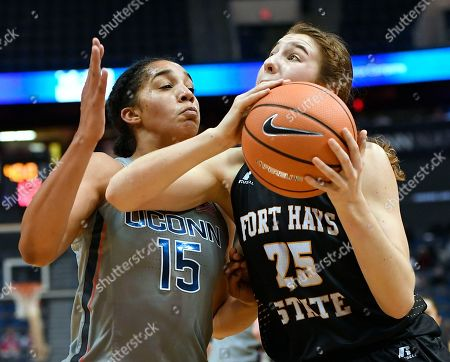 Stock Picture of Gabby Williams, Belle Barbieri. Connecticut's Gabby Williams (15) guards Fort Hays State's Belle Barbieri (25) during the first half an NCAA women's college exhibition basketball game, in Hartford, Conn