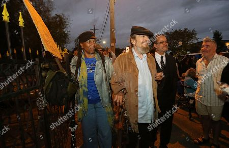"""New Orleans musicians Charmaine Neville, left, and """"Dr. John"""" Mac Rebennack, center, arrive at the former home of Fats Domino, during a second line parade honoring the music legend, in New Orleans, . The thousand-strong group marched and danced from Vaughn's Lounge to Domino's former home in the Lower 9th Ward. Domino, a New Orleans native, died this past week"""