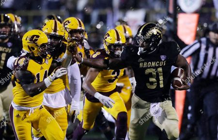 Western Michigan running back Jarvion Franklin is chased on the sidelines by Central Michigan defensive back Josh Cox (14) during the first half of an NCAA college football game, in Kalamazoo, Mich