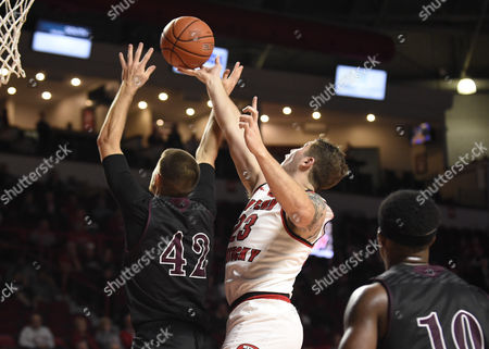 Stock Photo of , 2017; Bowling Green, KY, USA WKU Hilltoppers forward Justin Johnson (23) and Campbellsville Tigers Shawn Johnson (42) fight for the rebound during a game between the Campbellsville Tigers vs the WKU Hilltoppers at E. A. Diddle Arena. (Mandatory Photo Credit: Steve Roberts/CSM)