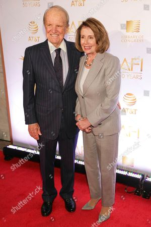 George Stevens, Jr., Nancy Pelosi. AFI Founding Director George Stevens, Jr., left, and Congresswoman Nancy Pelosi attend AFI's 50th Anniversary Gala at The Library of Congress, in Washington