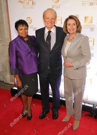 Stock Image of Carla Hayden, George Stevens, Jr., Nancy Pelosi. Librarian of Congress Dr. Carla Hayden, from left, AFI Founding Director George Stevens, Jr., and Congresswoman Nancy Pelosi attend AFI's 50th Anniversary Gala at The Library of Congress, in Washington