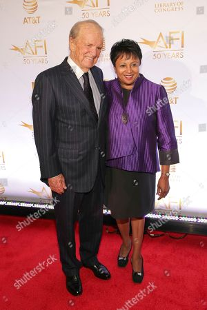 Stock Photo of George Stevens, Jr., Carla Hayden. AFI Founding Director George Stevens, Jr., left, and Librarian of Congress Dr. Carla Hayden attend AFI's 50th Anniversary Gala at The Library of Congress, in Washington