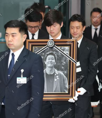 Stock Photo of Members of a funeral procession for the late South Korean actor Kim Joo-hyuk carry his portrait and coffin at the Asan Medical Center in Seoul, South Korea, 02 November 2017. South Korean actor Kim Joo-hyuk died in a car crash on 30 October at the age of 45.