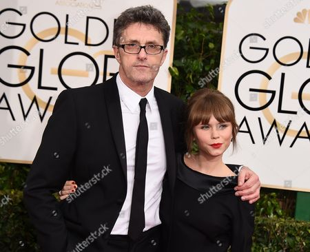 """Filmmaker Pawel Pawlikowski, left, and actress Agata Trzebuchowska from the film """"Ida,"""" arrive at the 72nd annual Golden Globe Awards in Beverly Hills, Calif. The film was nominated for an Oscar Award for best foreign language film on . The 87th Annual Academy Awards will take place on Sunday, Feb. 22, 2015 at the Dolby Theatre in Los Angeles"""