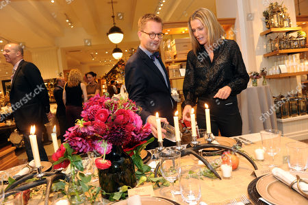 "Stock Photo of Nathan Turner, left, shows his tablescape to model, designer and author India Hicks at the book launch for ""Nathan Turner's American Style: Classic Design & Effortless Entertaining"" hosted by Pottery Barn in New York"