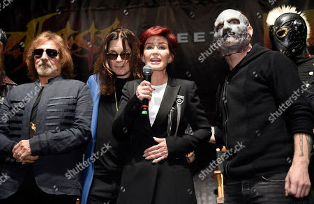 "Left to right, Geezer Butler and Ozzy Osbourne of Black Sabbath, Osborne's wife Sharon and Corey Taylor of Slipknot take part in a news conference at the Hollywood Palladium, in Los Angeles. The ""Ozzfest Meets Knotfest"" multi-stage camping festival on Sept. 24-25 at the San Manuel Amphitheater and Festival Grounds in San Bernardino, Calif. was announced at the news conference"