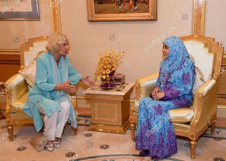 Stock Photo of Camilla Duchess of Cornwall and Queen Saleha of Brunei at Istana Nurul Iman