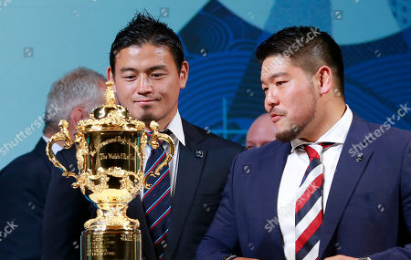 Ayumu Goromaru, Kensuke Hatakeyama. Japan's rugby players Ayumu Goromaru, left, and Kensuke Hatakeyama look at the Webb Ellis Cup during the match schedule announcement for the 2019 Rugby World Cup