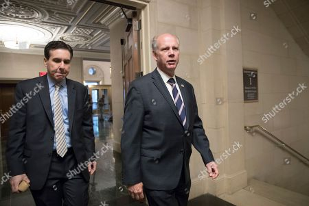 Rep. Dan Donovan, R-N.Y., right, who represents Staten Island and South Brooklyn, arrives for a briefing on the GOP's far-reaching tax overhaul, the first major revamp of the tax system in three decades, on Capitol Hill in Washington, . Donovan and other New York and New Jersey lawmakers have been concerned about the possible loss of federal deductions for state and local taxes in the GOP tax overhaul