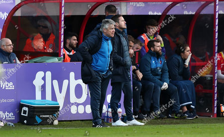 Steve Perryman, Director of Football for Exeter City helps lead the team from the sidelines in the absence of Manager Paul Tisdale