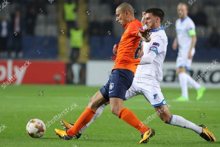 Basaksehir's Gokhan Inler, left, controls the ball in front of Hoffenheim's Florian Grillitsch right, during the Europa League group C soccer match between Basaksehir and Hoffenheim, at the Fatih Terim stadium in Istanbul
