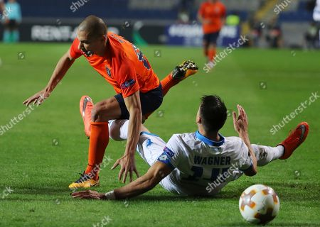 Stock Image of Basaksehir's Gokhan Inler, left, controls the ball in front of Hoffenheim's Sandro Wagner, right, during the Europa League group C soccer match between Basaksehir and Hoffenheim, at the Fatih Terim stadium in Istanbul