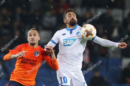 Stock Photo of Basaksehir's Gokhan Inler, left, controls the ball in front of Hoffenheim's Florian Grillitsch right, during the Europa League group C soccer match between Basaksehir and Hoffenheim, at the Fatih Terim stadium in Istanbul