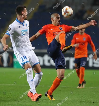 Basaksehir's Gokhan Inler, right, tries to control the ball in front of Hoffenheim's Sandro Wagner, left, during the Europa League group C soccer match between Basaksehir and Hoffenheim, at the Fatih Terim stadium in Istanbul