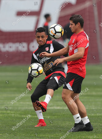 Peruvian players Yoshimar Yotun (L) and Aldo Corzo (R) participate in a training session at the Videna in Lima, Peru, 02 November 2017. The Peruvian team will face New Zealand in two games for the play-off of the 2018 World Cup in Russia.