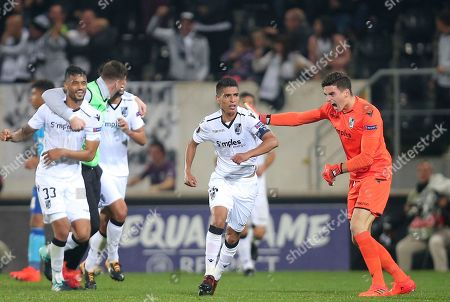 Vitoria's Paolo Hurtado, center, celebrates after scoring the opening goal during the Europa League group I soccer match between Vitoria SC and Olympique de Marseille at the D. Afonso Henriques stadium in Guimaraes, Portugal