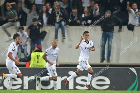 Vitoria's Paolo Hurtado, right, celebrates after scoring the opening goal during the Europa League group I soccer match between Vitoria SC and Olympique de Marseille at the D. Afonso Henriques stadium in Guimaraes, Portugal