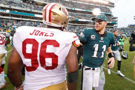 Carson Wentz, Datone Jones. Philadelphia Eagles quarterback Carson Wentz talks with San Francisco 49ers defensive end Datone Jones during an NFL football game, in Philadelphia