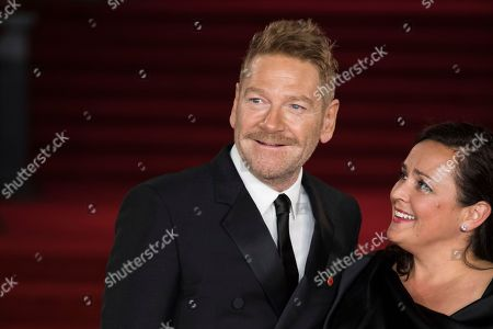 Stock Picture of Kenneth Branagh, Lindsay Brunnock. Kenneth Branagh and Lindsay Brunnock pose for photographers upon arrival at the World premiere of the film 'Murder On The Orient Express' in London