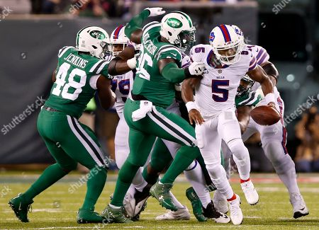 New York Jets defensive end Muhammad Wilkerson (96) grabs at Buffalo Bills quarterback Tyrod Taylor (5) during the first half of an NFL football game, in East Rutherford, N.J