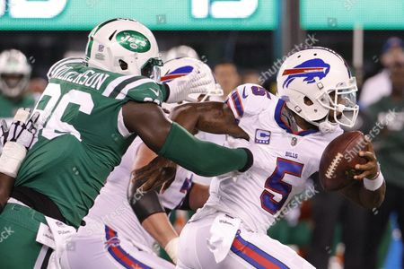 , 2017, Buffalo Bills quarterback Tyrod Taylor (5) scrambles with the ball away from New York Jets defensive end Muhammad Wilkerson (96) during the NFL game between the Buffalo Bills and the New York Jets at MetLife Stadium in East Rutherford, New Jersey. The New York Jets won 34-21