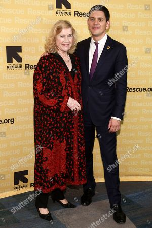 Liv Ullmann, left, and David Miliband, right, attend the International Rescue Committee's Freedom Award Dinner at the New York Hilton Midtown, in New York