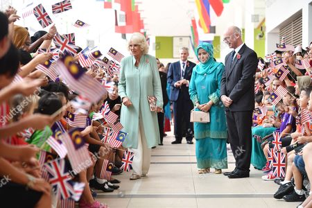 Stock Photo of Camilla Duchess of Cornwall and Raja Zarith Sofiah meet students at the International School Parkcity