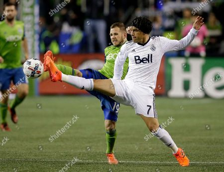Harrison Shipp, Christian Bolanos. Seattle Sounders' Harrison Shipp (19) and Vancouver Whitecaps' Christian Bolanos both vie for the ball during the first half of the second leg of an MLS soccer Western Conference semifinal, in Seattle