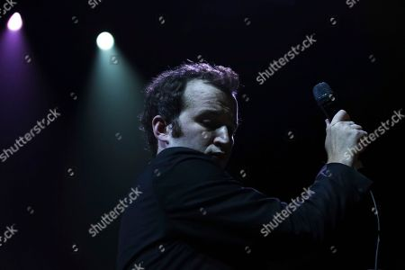 Baio, Chris Baio. Singer Baio performs on stage as an opening act for The Shins at The Anthem, in Washington