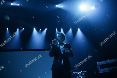 Stock Photo of Baio, Chris Baio. Singer Baio performs on stage as an opening act for The Shins at The Anthem, in Washington