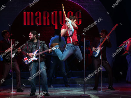 Matthew Wycliffe, who plays Jude, jumps with his guitar, alongside Mark Pearce, who plays Wild Thing, as they perform a scene from Carnaby Street, a new musical by Bob Thomson, which is set in London's west end in the sixties, at the Hackney Empire in east London