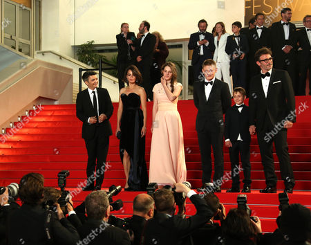 From left, Thomas Langmann, Berenice Bejo, Zukhra Duishvili, Maxim Emelianov, Abdul-Khalim Mamatsuiev and Michel Hazanavicius leave the screening of The Search at the 67th international film festival, Cannes, southern France