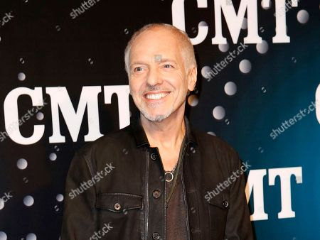 "Peter Frampton posing on the red carpet at the CMT ""Artists of the Year at Bridgestone Arena in Nashville, Tenn. The Musicians Hall of Fame inducted 12 new members, across the genres, including bluesman Buddy Guy, British rock guitarist Peter Frampton and pedal steel player and country singer Barbara Mandrell"