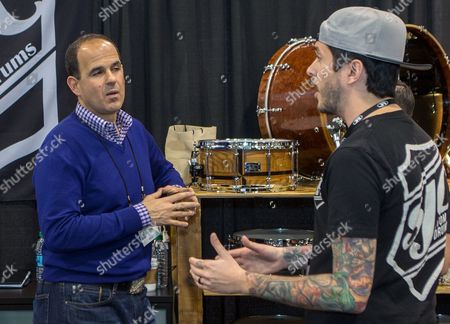 """Marcus Lemonis, of the TV show """"The Profit,"""" left, films at the SJC Custom Drums booth during the 2015 National Association of Music Merchants (NAMM) show at the Anaheim Convention Center in Anaheim, Calif"""