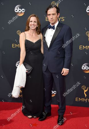 Nathan Darrow, right, and guest arrive at the 68th Primetime Emmy Awards, at the Microsoft Theater in Los Angeles