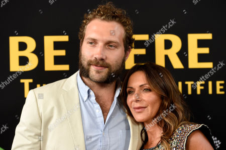 "Vashti Whitfield, widow of actor Andy Whitfield, right, poses with actor Jai Courtney at the premiere of the film ""Be Here Now (The Andy Whitfield Story),"" in Beverly Hills, Calif. Andy Whitfield died of non-Hodgkin lymphoma in 2011"