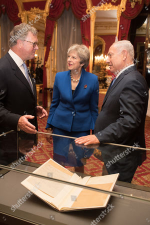 Lord Roderick Balfour with Prime Minister Theresa May and Prime Minister of Israel Benjamin Netanyahu, standing next to the original Balfour Declaration.
