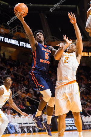 Shaun Jones #5 of the Carson Newman shoots the ball over Grant Williams #2 of the Tennessee Volunteers during the NCAA basketball exhibition game between the University of Tennessee Volunteers and the Carson-Newman University Eagles at Thompson Boling Arena in Knoxville TN Tim Gangloff/CSM