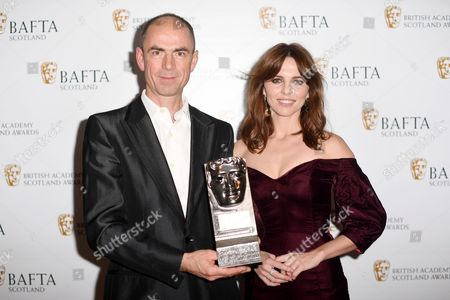 John Hodge accepting on the behalf of Ewen Bremner - Actor Film - T2 Trainspotting and Ophelia Lovibond