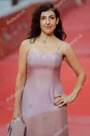 """Actress Karina Gidi poses for photos on the red carpet of the movie """"The Eternal Feminine"""", at the 12th edition of the Rome Film Fest, in Rome"""
