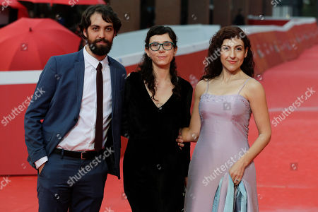 """From left, actor Pedro De Tavira, Mexican film director Natalia Beristain and actress Karina Gidi pose for photos on the red carpet of the movie """"The Eternal Feminine"""", at the 12th edition of the Rome Film Fest, in Rome"""