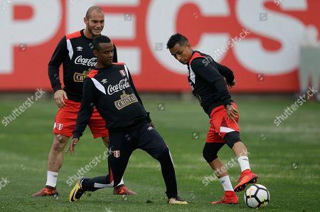 Peru national soccer team members Yoshimar Yotun, right, Nilson Loyola, center, and Adrian Zela, train in Lima, Peru, . Peru will face New Zealand in Wellington on Nov. 11, in an intercontinental World Cup playoff