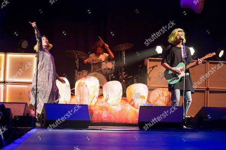 "Hannah Hooper, Ryan Rabin, Christian Zucconi. Hannah Hooper, from left, Ryan Rabin and Christian Zucconi of the band Grouplove perform in concert as the opening act for Imagine Dragons during their ""Evolve Tour"" at The Wells Fargo Center, in Philadelphia"