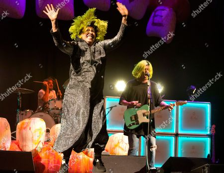 "Hannah Hooper, Christian Zucconi. Hannah Hooper, left, and Christian Zucconi of the band Grouplove perform in concert as the opening act for Imagine Dragons during their ""Evolve Tour"" at The Wells Fargo Center, in Philadelphia"