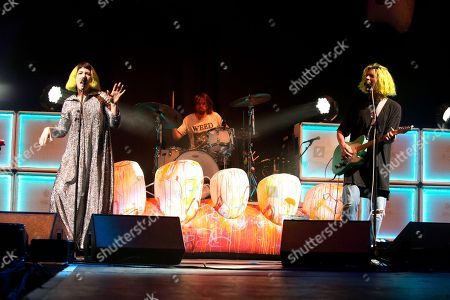 """Hannah Hooper, Ryan Rabin, Christian Zucconi. Hannah Hooper, from left, Ryan Rabin and Christian Zucconi of the band Grouplove perform in concert as the opening act for Imagine Dragons during their """"Evolve Tour"""" at The Wells Fargo Center, in Philadelphia"""