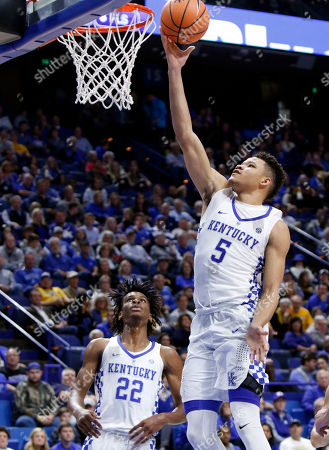 Kevin Knox, Shai Gilgeous-Alexander. Kentucky's Kevin Knox (5) takes an uncontested shot as teammate Shai Gilgeous-Alexander (22) watches during the second half of an NCAA college basketball exhibition game against Centre, in Lexington, Ky